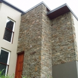 Featured exterior stone  wall.